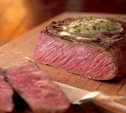 Image of Rosemary-Marinated Rib Eye Steaks with Lemon-Pepper Butter