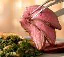Image of Rosemary Leg of Lamb with Warm Kale and White Beans
