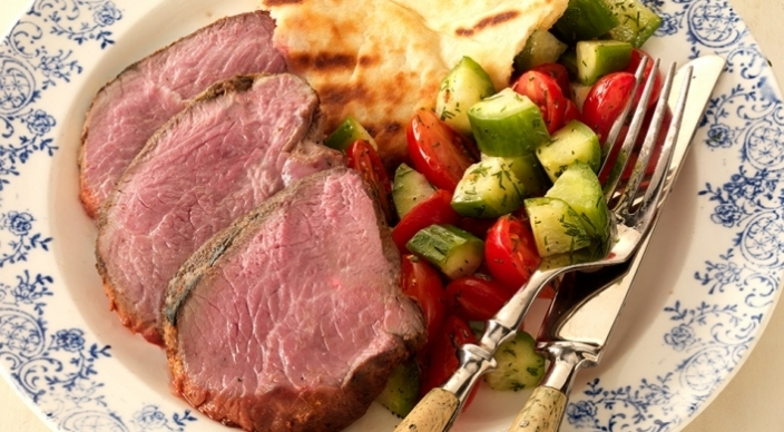 Image of Spicy Marinated Leg of Lamb with Tomato-Cucumber Salad